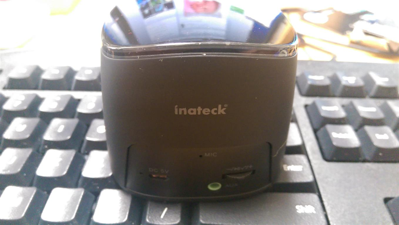 Inateck Portable Bluetooth Speaker on a keyboard